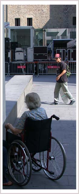 An image of a woman who is a wheelchair user and a man with a skateboard